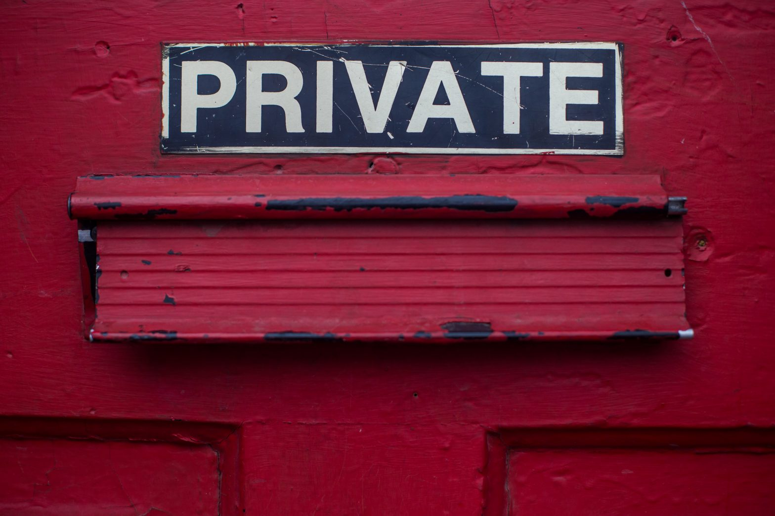 A red door with a sign reading 'private' on it
