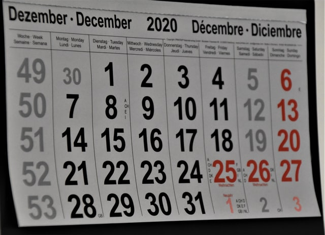 paper wall calendar showing month of December 2020