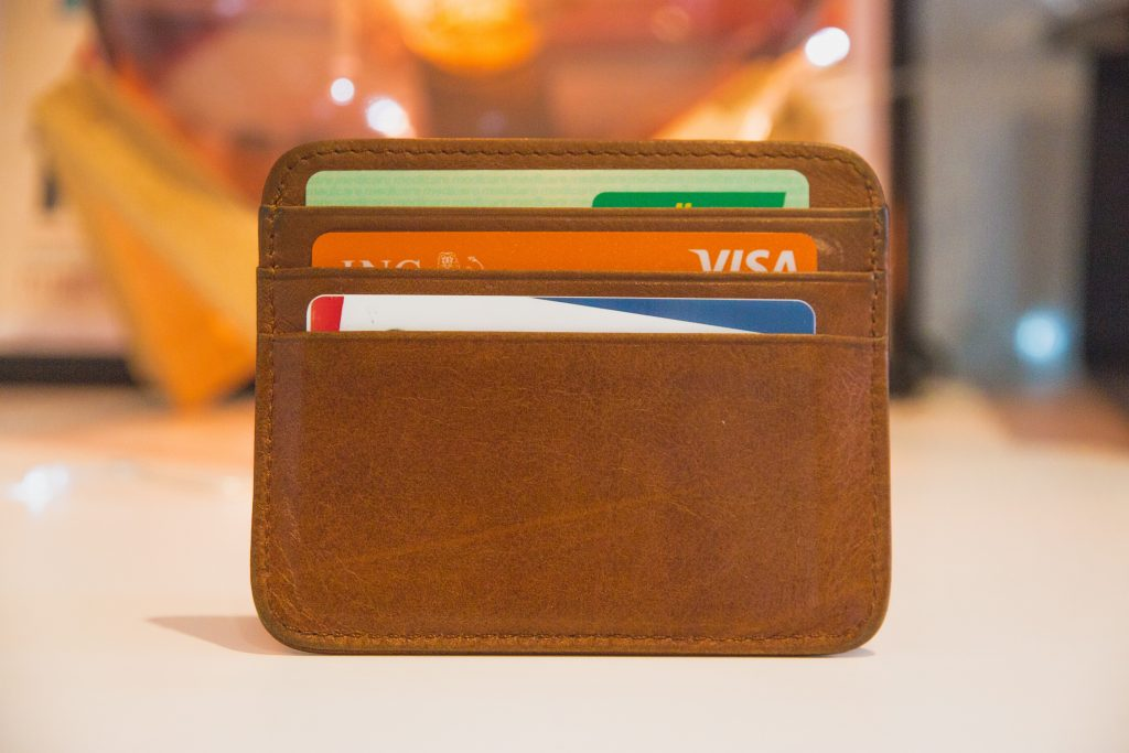 Brown leather card holder containing three bank cards